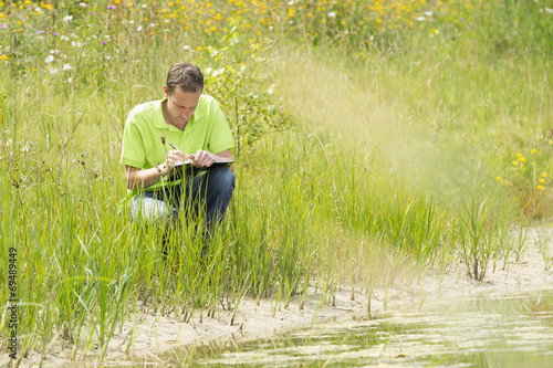 Enviromental scientist researching the environment and natural d - 69489449