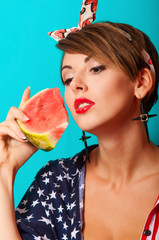 Young beautiful girl with watermelon in hands