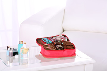 Handbag with accessorises and perfumes in bottles