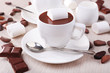 Cups of hot chocolate on table, close up