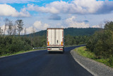 white truck transports freight