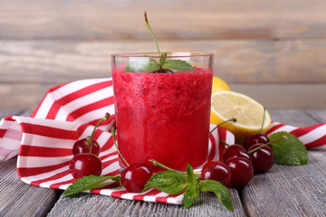 Fresh cold cherry cocktail with mint and lemon