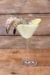 Martini glass of fresh tasty prawns with lemon and sauce
