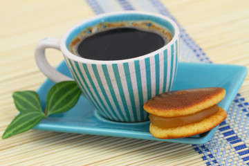 "Cup of coffee with Japanese cookie ""kuri dora"""