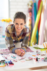 Portrait of smiling tailor in studio