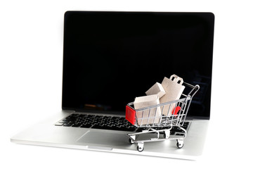Shopping bags and boxes in shopping cart