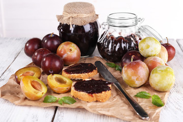 Plum jam, slices of bread with plum jam and fresh plums in