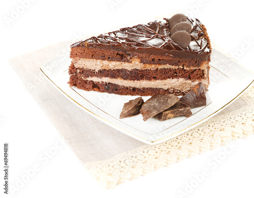 canvas print picture Chocolate cake on plate isolated on white