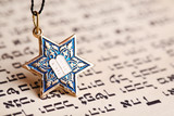 Star David pendant on old paper page background