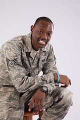 Military man sitting and smiling at the camera