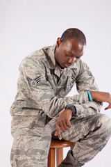 Black military man looking thoughtful