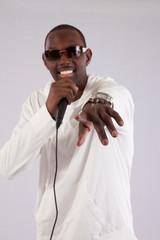 black man singing into a micdrophone