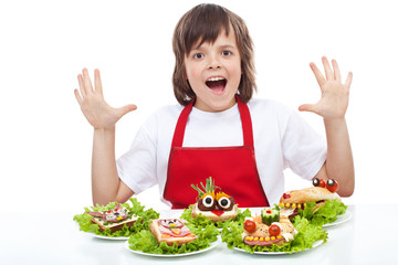 Happy chef with creative food creature sandwiches