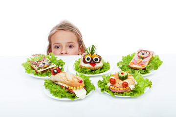 Little girl looking at creative food creatures