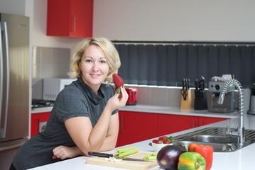 Woman having a strawberry