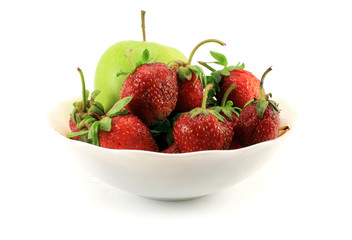 Juicy, ripe strawberries with green Apple in the Cup. Isolated o