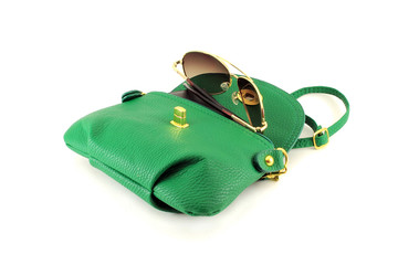 A handbag with sunglasses. Isolated object on white background.