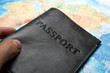 canvas print picture - passport in the bag on a map