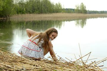 Long-haired beautiful girl enjoying the nature