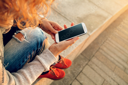 Leinwandbild Motiv using smart phone