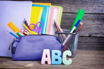 school supplies labeled ABC