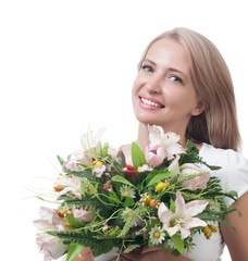 Beautiful woman with a bouquet of flowers isolated on white back