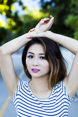 Asian American Woman Outdoor Portrait Arms On Head