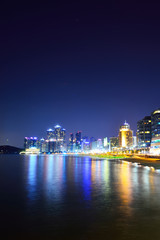 skyline at night with Haeundae district in Busan, South Korea