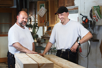 Two Carpenters with Wooden Beams
