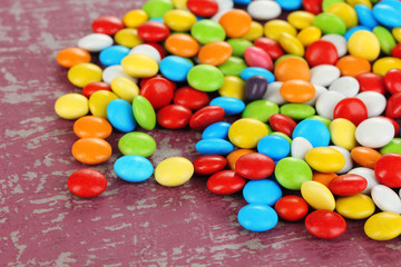 Colorful candies on bright background