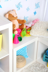 Colorful toys on fluffy carpet in children room