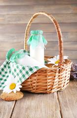 Tasty snack in basket on wooden background indoor