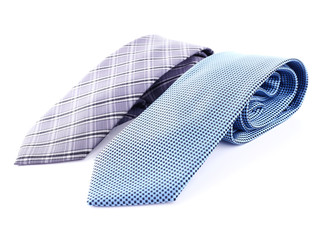 Blue and grey ties on white background isolated