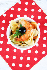 Fresh prawns with coloured macaroni and olives in a round bowl