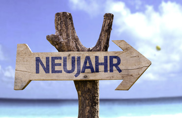 """Neujahr"" (In German: New Year) sign with a beach on background"