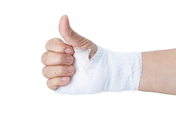 Thumb up showing by hand with white bandages isolated on white