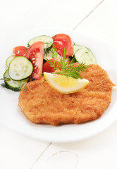 Schnitzel and salad with fresh vegetables
