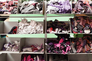 Rack with lots of colorful shoe insoles