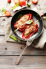 Delicious stuffed peppers in frying pan on table close-up