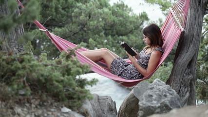 Girl in hammock e-book reading