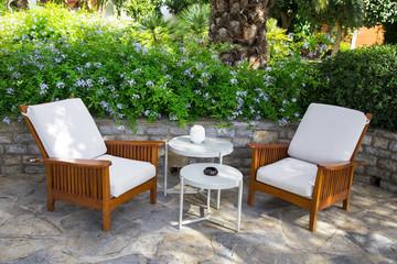 A pair of modern comfortable garden sofa in the home garden