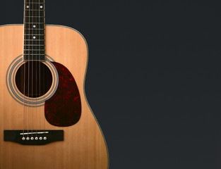 Wooden guitar isolated on black - Clipping path included
