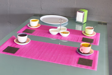 Table in furniture showroom decorated with coffee cups