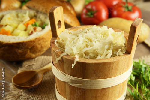 Sauerkraut in a wooden barrel - 69509402