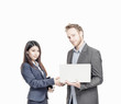 Inter racial business agreement. Man and woman shaking hands. Is