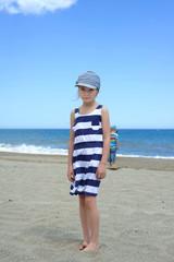 Serious cute little girl on the beach