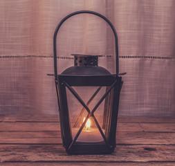 Lantern on wooden table, retro processing