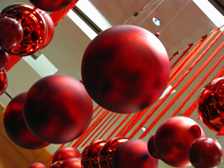 Red Ornaments and Ribbons Hanging From Ceiling