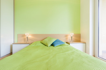 Interior of bedroom with green wall