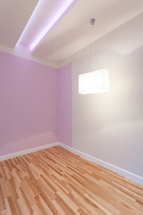 Empty room with illuminated ceiling